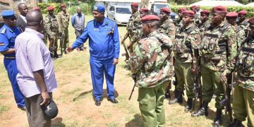 Interior CS Fred Matiang'i and Police IG Hillary Mutyambai (centre) when they visited Matungu in the wake of killings in the area. PHOTO/NPS