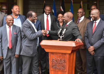 Deputy President William Ruto and Kakamega Governor Wycliffe Oparanya share a light moment after the meeting. Photo/DPPS