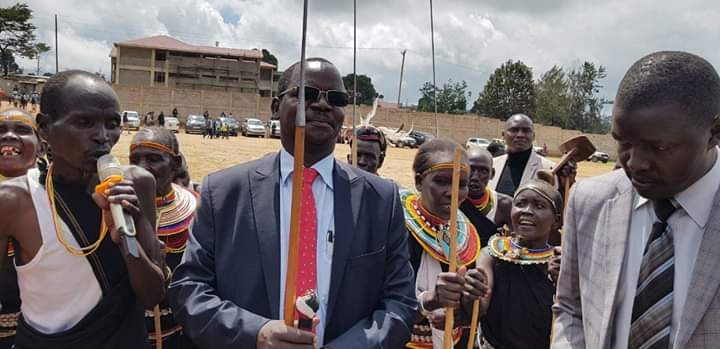 West Pokot Governor John Lonyangapuo (centre)