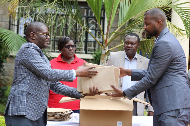 Mr. Daniel Karori (right) the CEO of the Firm receiving forms of applicants for the various positions from the acting County secretary Mr.Philip Gavuna (left)