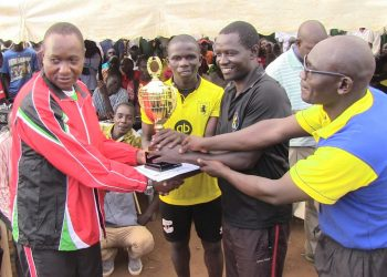 St. Peter's Mumias captain receiving the boys' football trophy