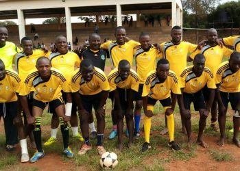 The Bungoma Journalists team pose for a group photo before the match