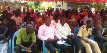 Kimatuni Sub- location Chief Joseph Mulongo in a pink shirt