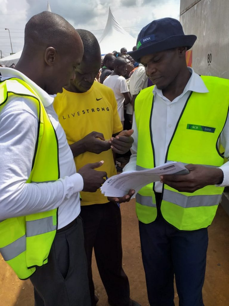 KCB staff registering a client to KCB Mobigrow