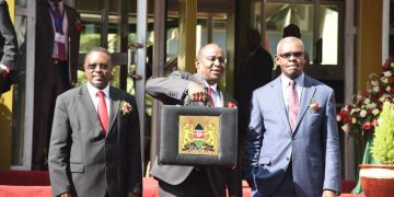 Treasury CS Henry Rotich (centre) and PS Kamau Thugge (right)