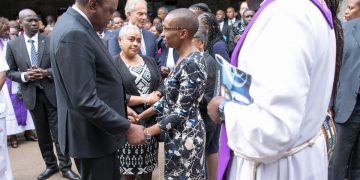 President Uhuru Kenyatta condoles with Wambui Collymore after the memorial service. Photo/PSCU