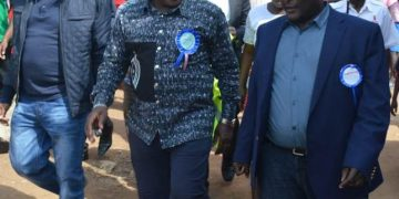 Vihiga Senator George Khaniri (right) and the Senate Speaker Ken Lusaka (centre) at Kapsotik Primary
