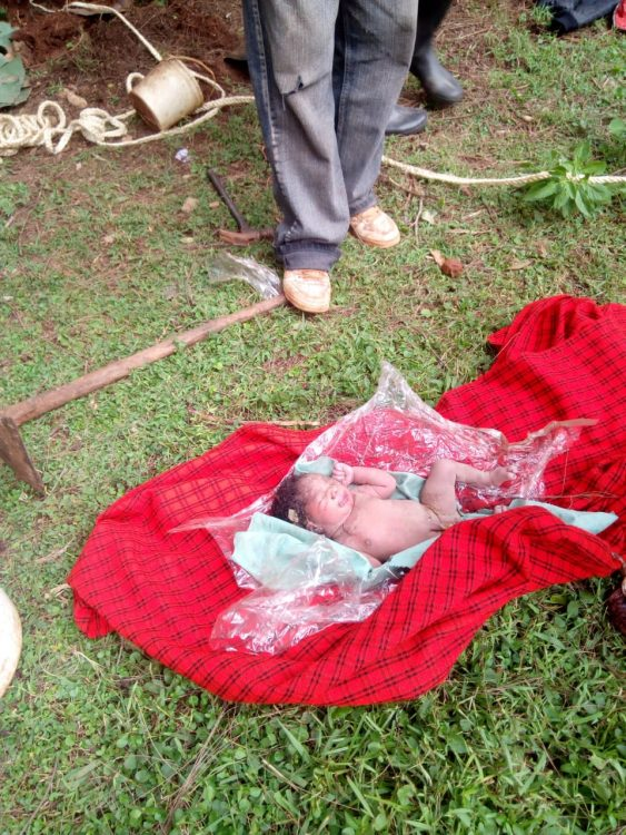 Police officers rescued the baby from the pit latrine