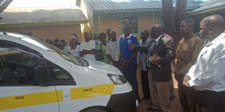 Dr. Anthony Opacha of Malaba of Outreach Baptist Church blesses a matatu procured Malaba Border Riders Sacco