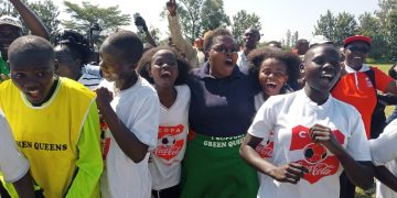Maeni Girls secondary school principal Lydia Shisima celebrates with her players after clinching a spot in the final