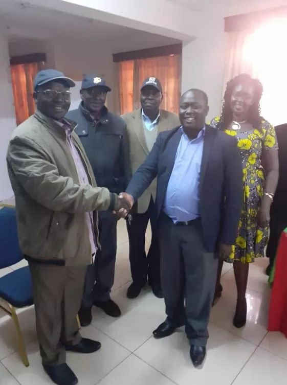 Governor John Lonyangapuo (left) shakes hands with Dennis Kapchok 'Mulmulwas'