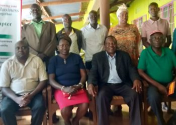 The chairman of the Kenya chamber of commerce Busia chapter,Peter Kubebea (middle-front row)with members of the chamber in Malaba