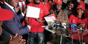 McDonald Mariga receiving the Jubilee certificate to vie for the Kibra seat. Photo/Courtesy