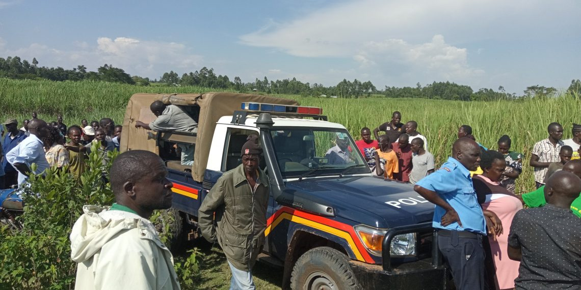 Nambale police officers and locals at the scene where the body was found