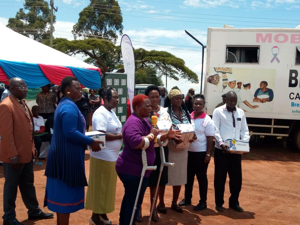 Nominated senator Dr. Gertrude Musuruve Inimah (with crutches) together with other leaders and health officials during the free cancer screening exercise at Lumakanda sports ground