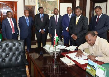 President Uhuru Kenyatta signing the Division of Revenue Bill 2019 into law. PHOTO/PSCU