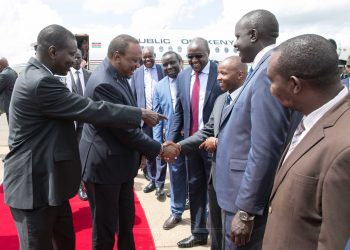 President Uhuru Kenyatta was welcomed by Uasin Gishu Governor Jackson Mandago (left) ahead of the passing out parade.PHOTO/PSCU