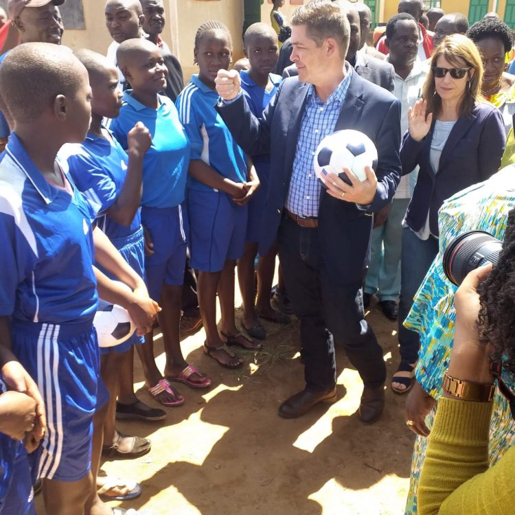 The US Ambassador to Kenya Kyle McCarter interacting with students in Kakamega during a past visit
