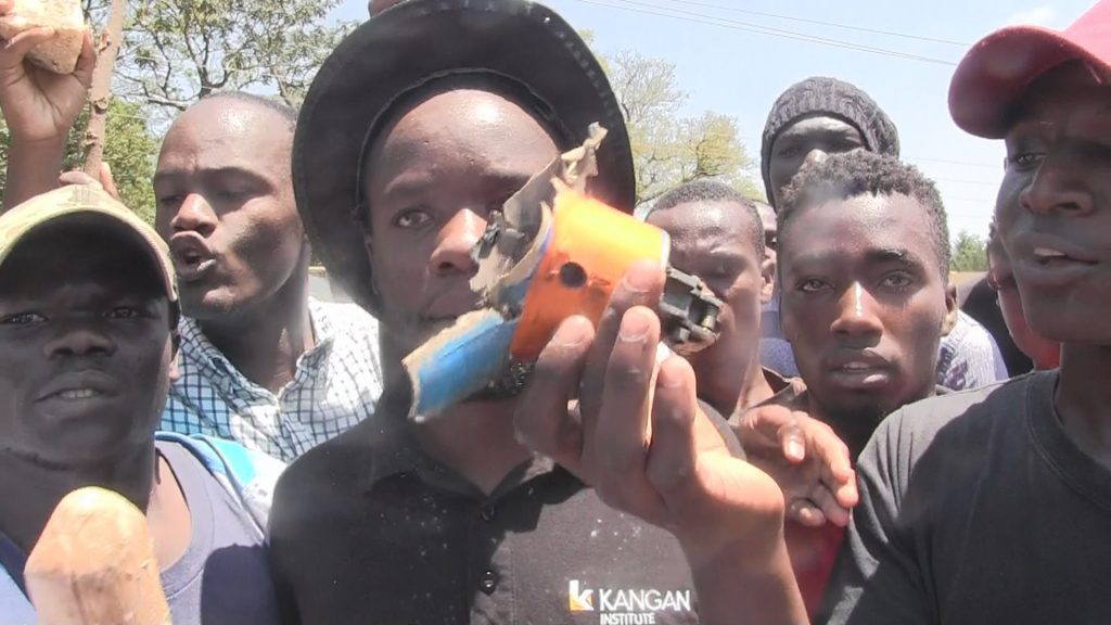 A student displaying a teargas canister during the demos