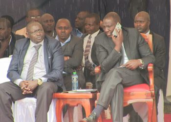 Deputy President William Ruto (right) with Trans Nzoia Deputy Governor Stanley Kenei Tarus (left)