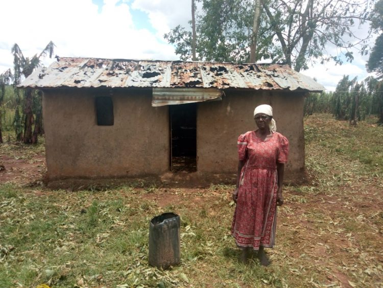 70-year-old Timinah Lusike outside her house