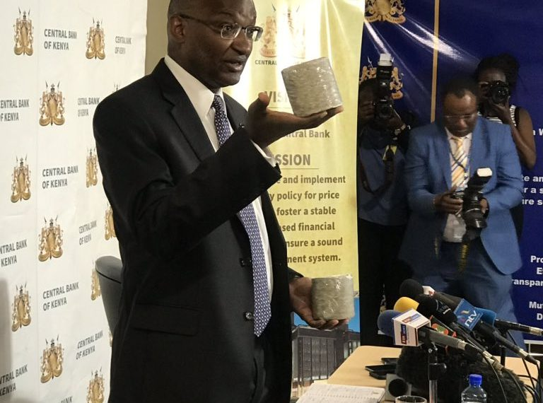 CBK Governor Patrick Njoroge holding briquettes worth Kshs 1,000,000 in shredded bank notes. Photo/CBK