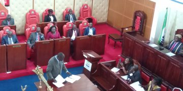Chakol South MCA Maskini Okodoi presenting his views on the Punguza Mizigo bill in the Busia County assembly