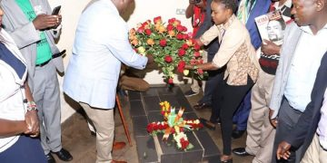 Nandi Governor Stephen Sang laying a wreath at the late Koitalel Samoei's Mausoleum