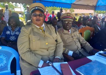 Likuyani Deputy County Commissioner Wilson Kimaiyo (right) with Sub County Administrator Doreen Amwoga during Mashujaa day celebrations at Soy Sambu primary school
