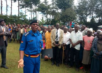 Likuyani sub county police commander Boniface Lisiolo addressing residents at Nzoia village in Sango sub location where a 65-year-old woman and her 13-year-old niece were raped and killed