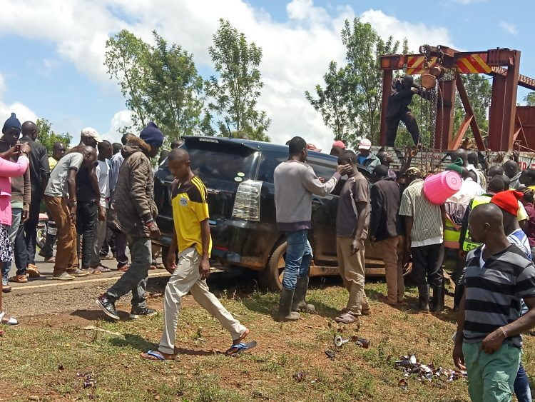 Locals around the vehicle that hit the boda boda operator