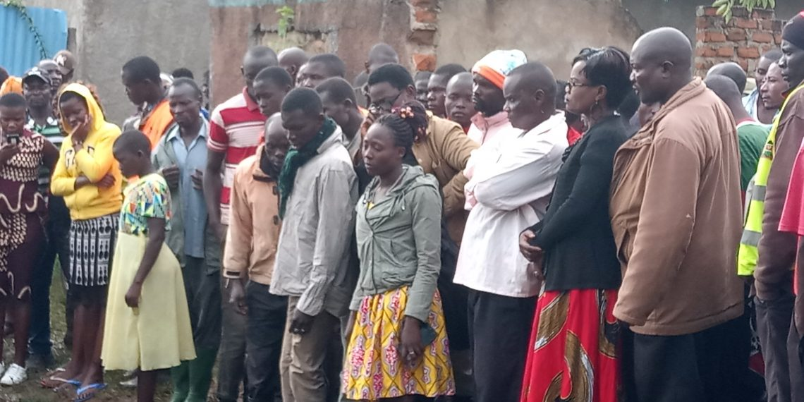 Residents and family members view the body of the slain boda boda operator killed in Nambale