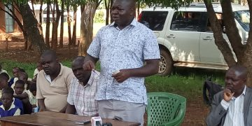 Teso South MP Geoffrey Omuse addressing teachers, pupils and parents of Busia township primary school