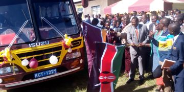 The leaders flagging off the bus