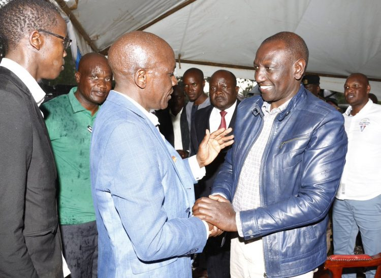 Deputy President William Ruto and former Kakamega Senator Boni Khalwale at Mama Adelaide's requeim mass at Malinya grounds, Kakamega County. Photo/DPPS