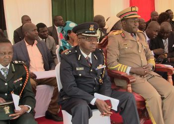 Trans Nzoia County Commissioner Sam Ojwang with police commander Ayub Ali during the Mashujaa Day fete