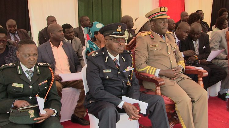 Trans Nzoia County Commissioner Sam Ojwang (right) with police commander Ayub Ali