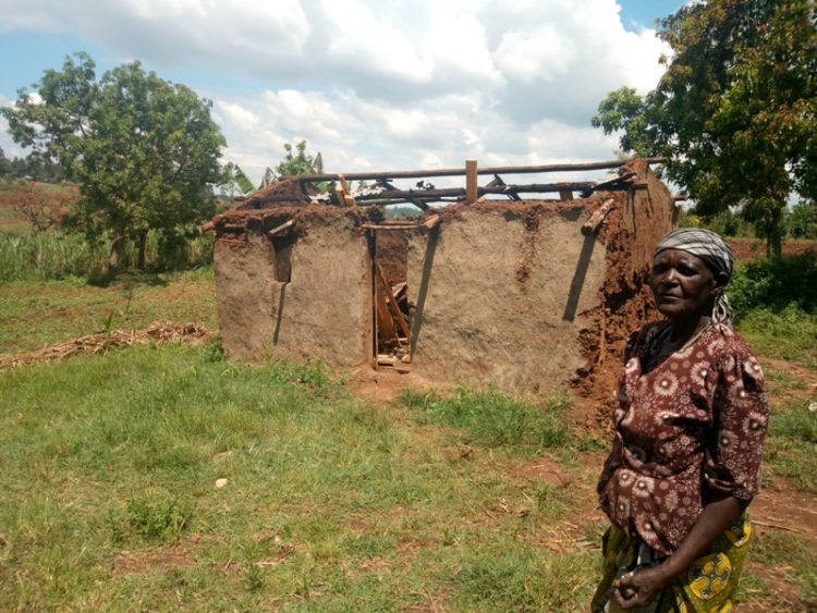 70-year-old Timina Lusike outside her house which was destroyed by a hailstorm