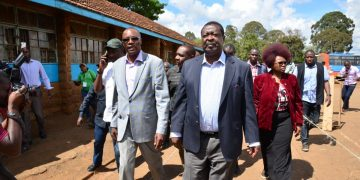 ANC party candidate Eliud Owalo, who cast his vote at the old Kibra school, accompanied by ANC party leader Musalia Mudavadi. Photo/Courtesy