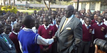 Education CS Prof. George Magoha interacting with Chavakali High School candidates when he visited the school