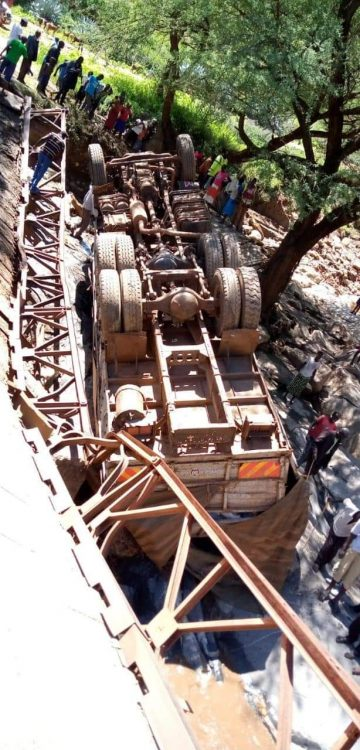 The bridge collapsed when a heavy truck was crossing over it