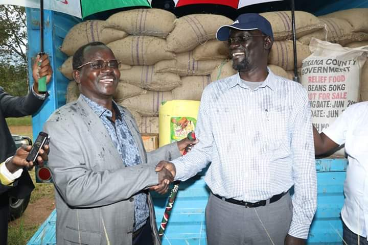 West Pokot Governor John Lonyangapuo (left) and Turkana Governor Josphat Nanok (right) when the aid was availed
