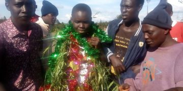 June Cheptoo Koech from Sang'alo Central Primary School (centre)