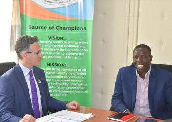Nandi Governor Stephen Sang with Nutrition International CEO Joel Spicer