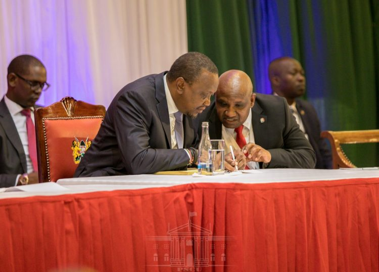 President Uhuru Kenyatta and KRA Commissioner General James Githii Mburu at the 2019 annual taxpayers day. Photo/PSCU