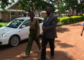 The suspect Geoffrey Osongo guarded by police after being tested at Nambale sub county hospital