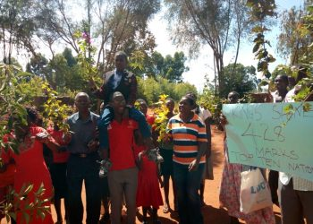 The top KCPE candidate in Lugari Stanley Adega Otwoma carried by his headteacher James Agesa as some parents, teachers and pupils of Kings Education Centre celebrate