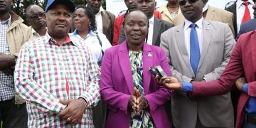 Peace ambassador Tegla Lorupe speaking to the press flanked by West Pokot Governor John Lonyangapuo (right)