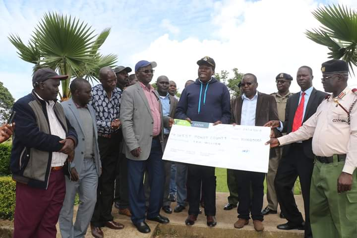 West Pokot Governor John Lonyangapuo receiving the donation