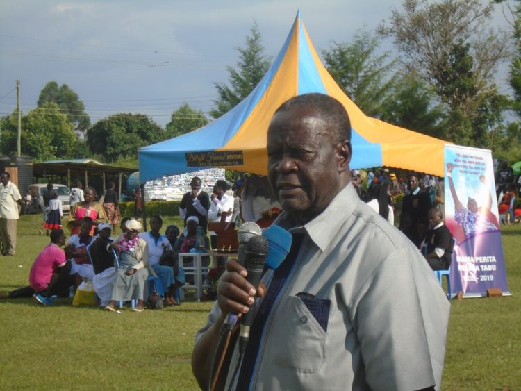 Former Minister Dr. Noah Wekesa addressing mourners during the burial of Perita Nelima Tabu in Lugari